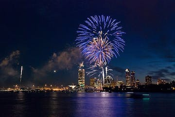 Fireworks display with Milwaukee skyline
