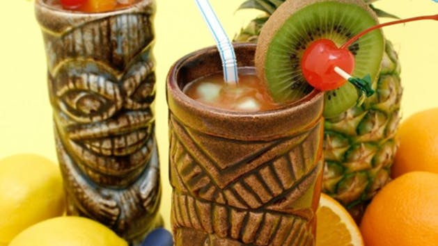 Tropical drinks in tiki mugs