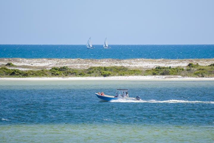 Driving a boat in Orange Beach, AL