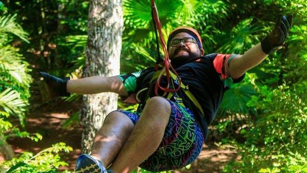 Man ziplining through jungle in Cancun