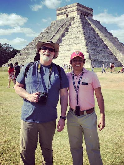 Carlos with guest in front of Chichen Itza