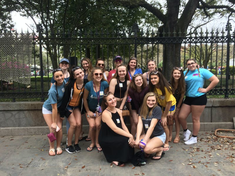 A group of cheerleaders that toured with Two Chicks Walking Tours in the New Orleans Metro area