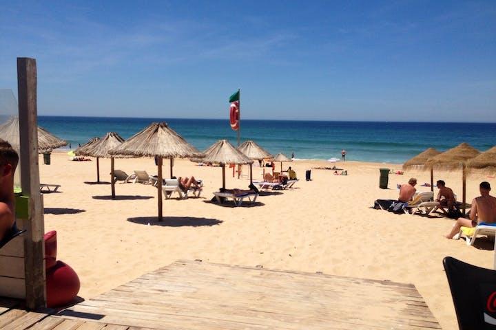 Lisbon-Beach-Straw-Umbrellas