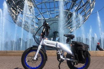 ebike in front of water fountain and globe statue