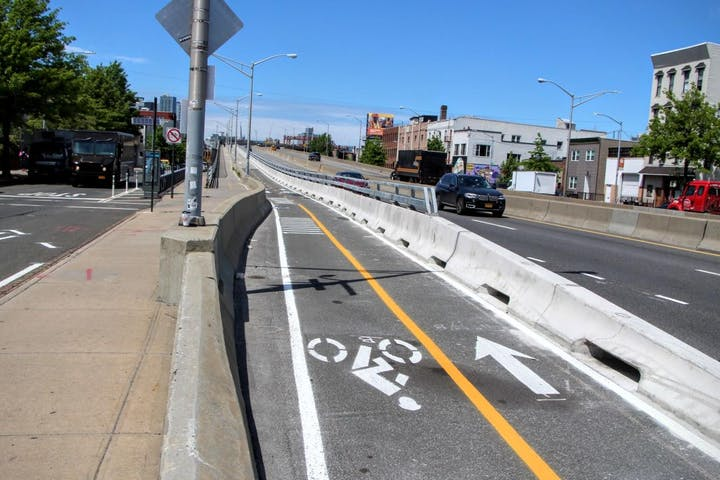 queens greenway image of bike path and sign