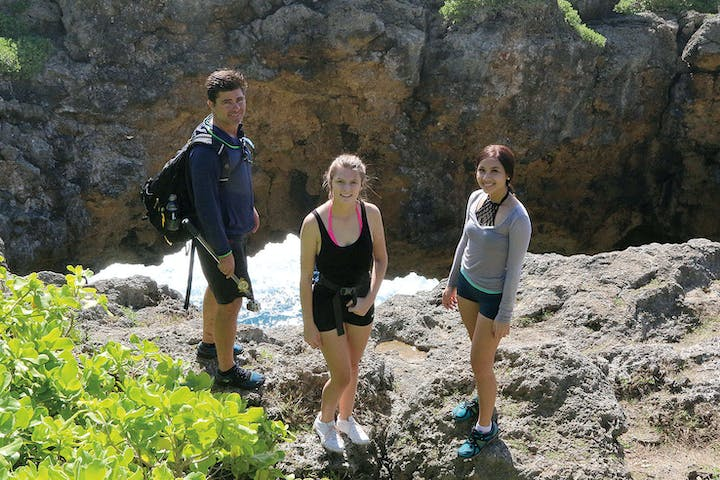 A group of 3 people during an eco hike