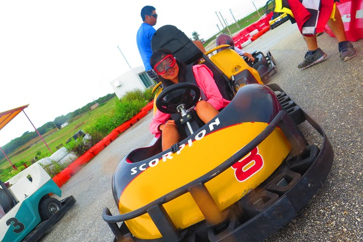 A woman having a fun time driving her go-kart