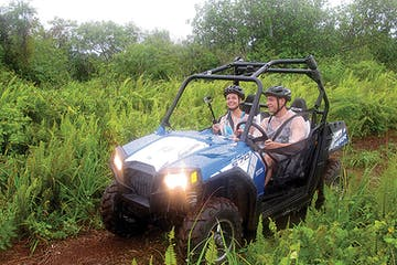 Two people in an off road buggy