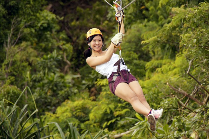 A girl enjoying her zipline adventure