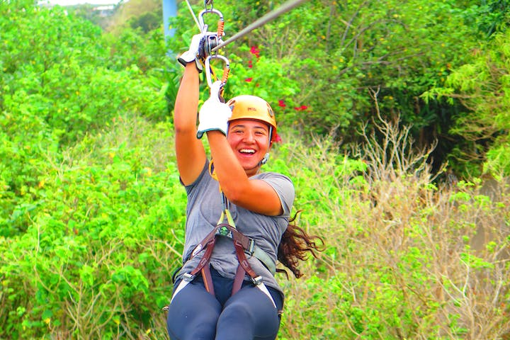 A girl is all smiles as she ziplines