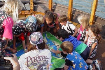 A group of kids looking at a map