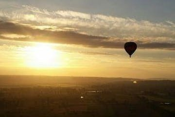 Hot air balloon taking off in the sunset