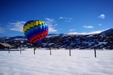 Hot air balloon ready for launch around the snow capped mountains of Washington