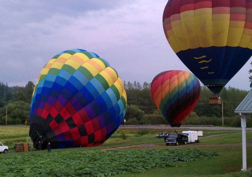 Three hot air balloons prepping for take off