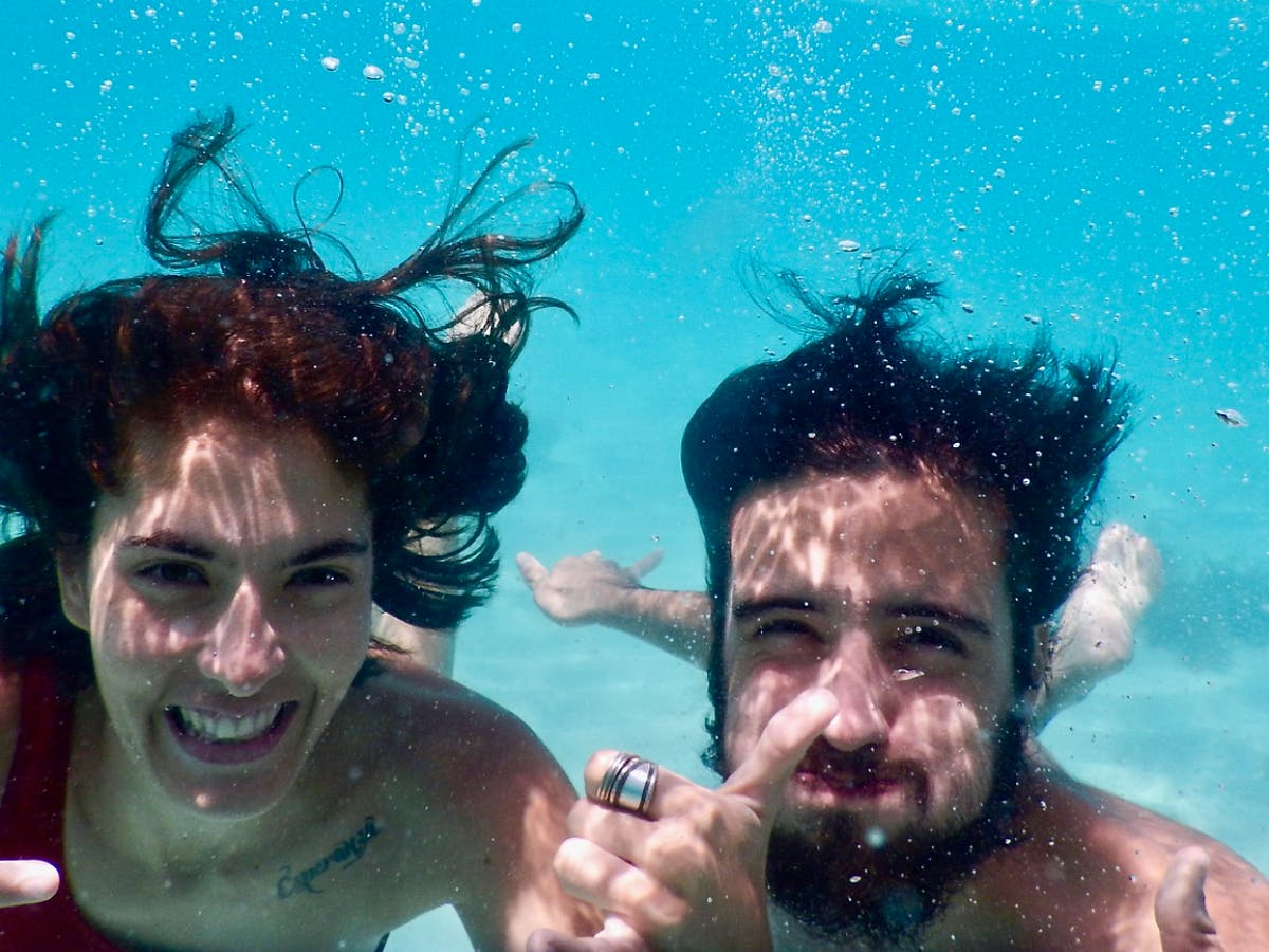 two people underwater