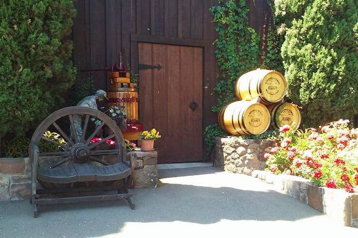 Barrels of wine in front wooden door