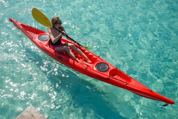A woman with a kayak