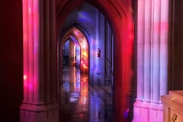 Purple and red light over the arches of the National Cathedral