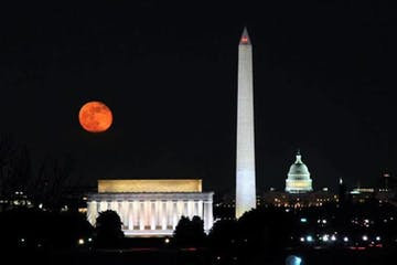A full red moon over the Nation's monuments