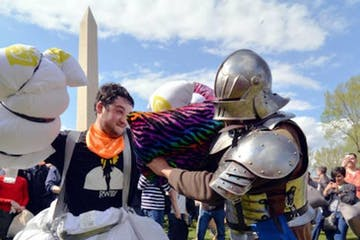 Two pillow fighters in front of the Washington Monument