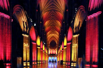 Red and yellow lights on the arches at the National Cathedral