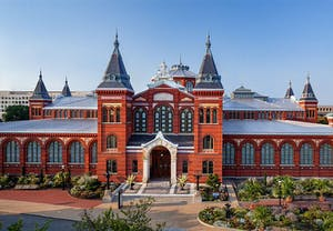 a large building with Arts and Industries Building in the background