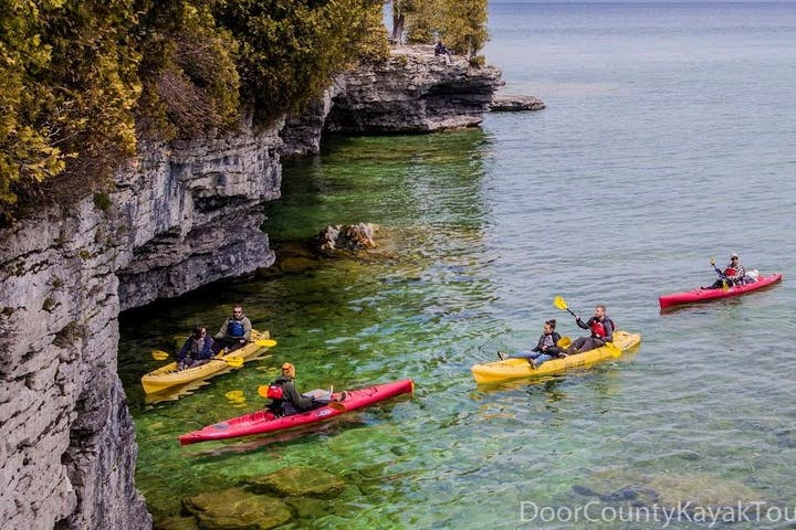 Kayakers paddling toward Cave Point in Wisconsin