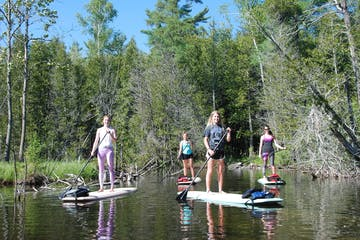 Group of women on standup paddleboards in Door County, Wisconsin