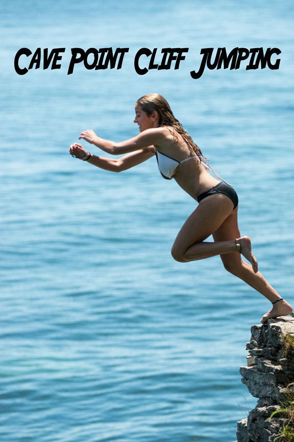 a girl jumping off of cave point cliffs