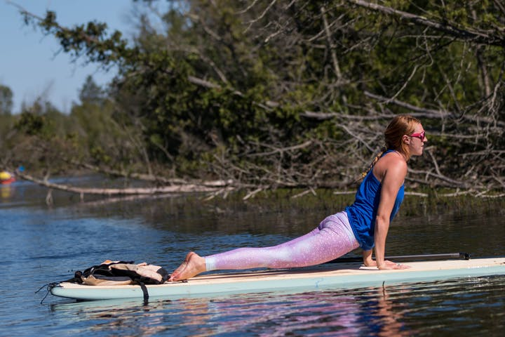 Woman performing yoga on SUP in Door County, Wisconsin