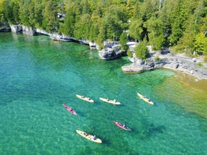 Door County coastline with kayaks in water