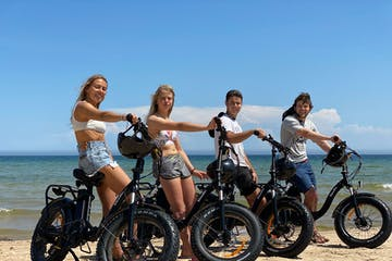 a group of people standing around a motorcycle