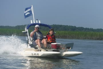 Man and boy on catamaran