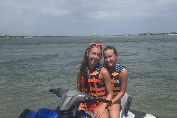 2 girls on a jet ski.