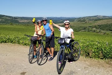 people with bikes in a field in Tuscany