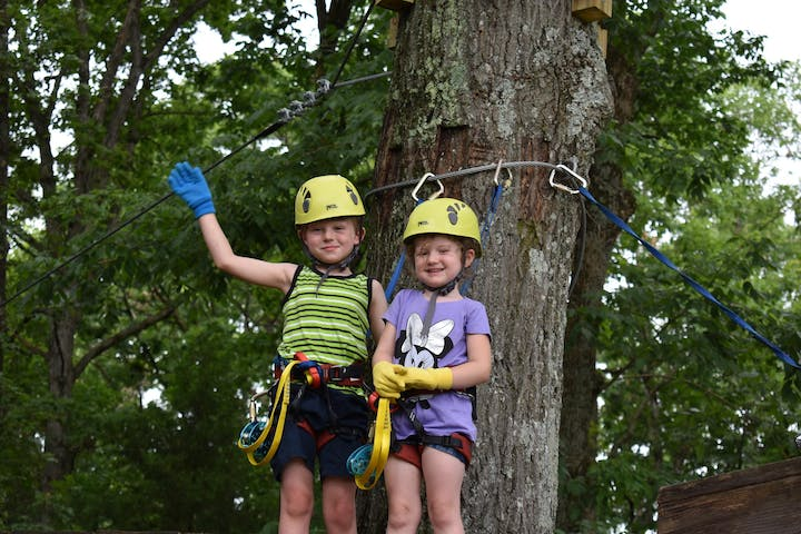 2 young children enjoying the Soaring Six kid-friendly zipline
