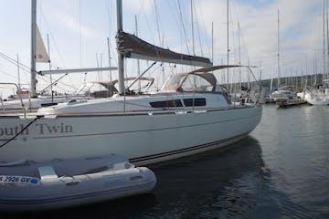 White sailboat at harbor