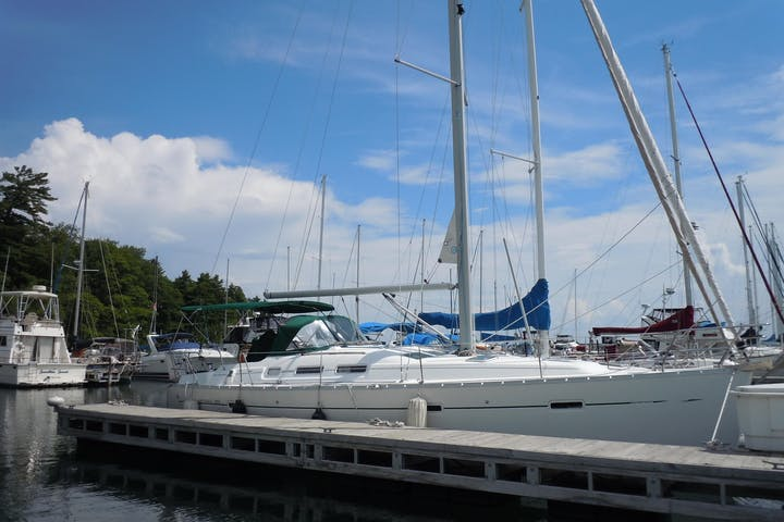Side view of Fly Away sailboat while docked
