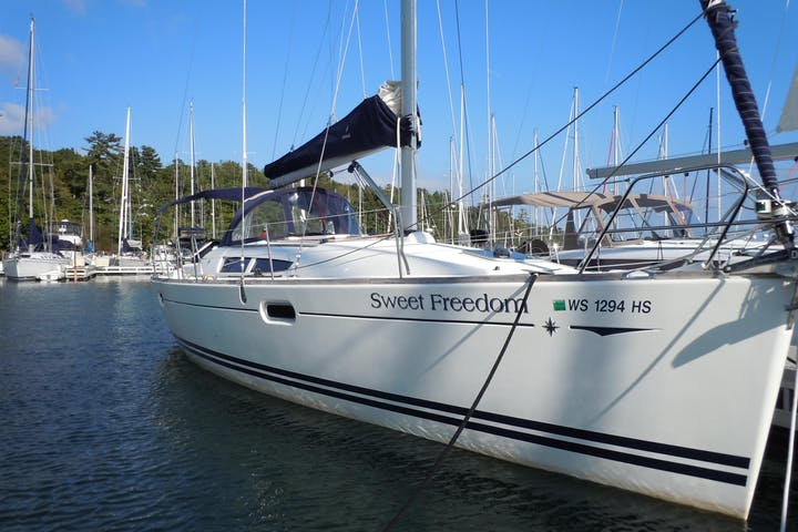 Front view of Sweet Freedom sailboat while docked