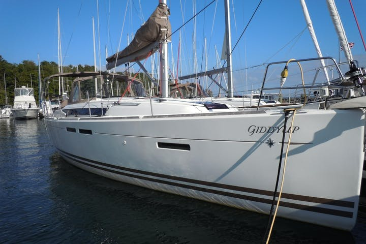 Side view of Giddyup sailboat while docked at harbor
