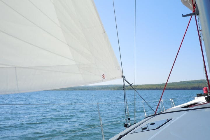 Looking out from bow of sailboat to lake
