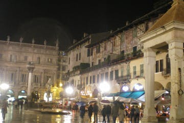 A square in the night in Verona