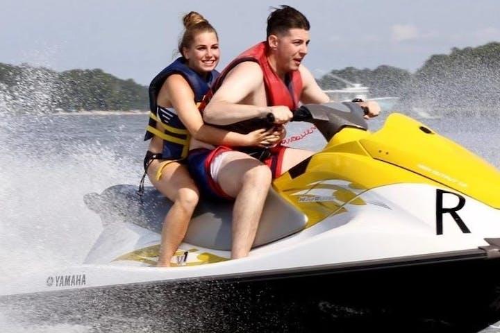 A couple enjoying a jet ski rental on Virginia Beach