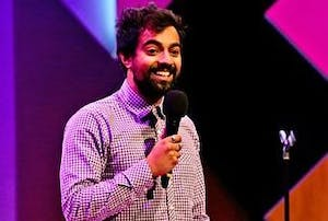 Anish Mohammed standing in front of a stage