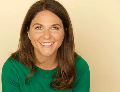 a smiling woman in a green shirt