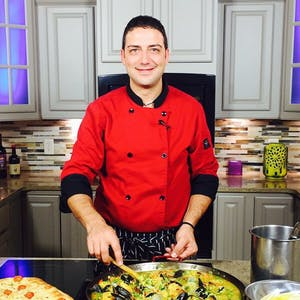 Fabio Carella cooking in a kitchen preparing food