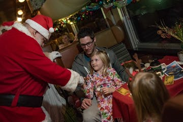 Santa entertaining kids inside train