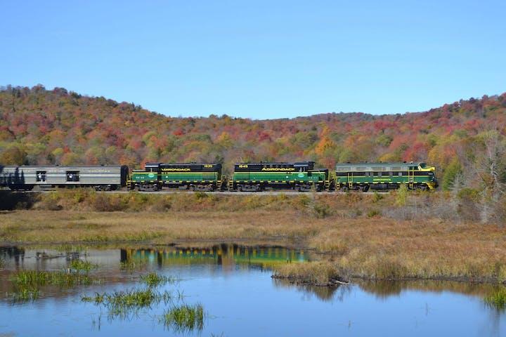 train riding down near a lake