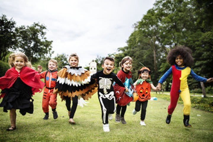 kids dressed up for halloween and running