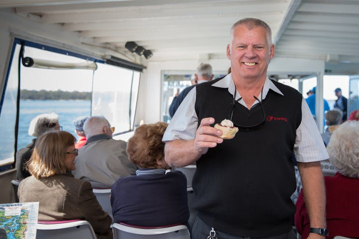 Ferryman Cruises Bribie man with scone